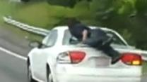 Raw: Man Seen Clinging to Trunk on NC Highway