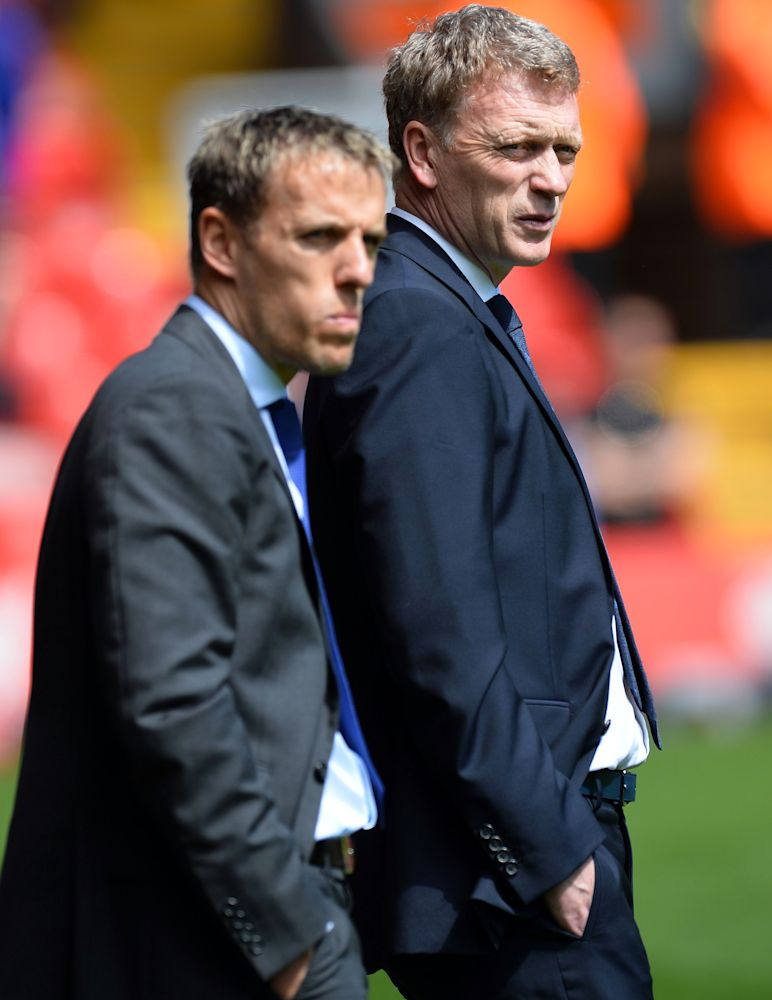 Phil Neville (left) stands with David Moyes before the start of the English Premier League match between Liverpool and Everton at the Anfield stadium in northwest England, on May 5, 2013