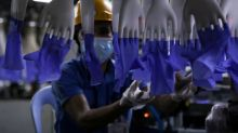 Malaysia rubber glove body pleads for go-ahead to restart factories