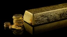 Gold hits over 2-week low as dollar rallies vs yen
