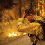 Northern California wildfires merge, forcing more from their homes