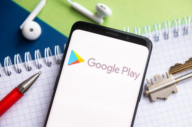 In this photo illustration, a Google Play logo seen...