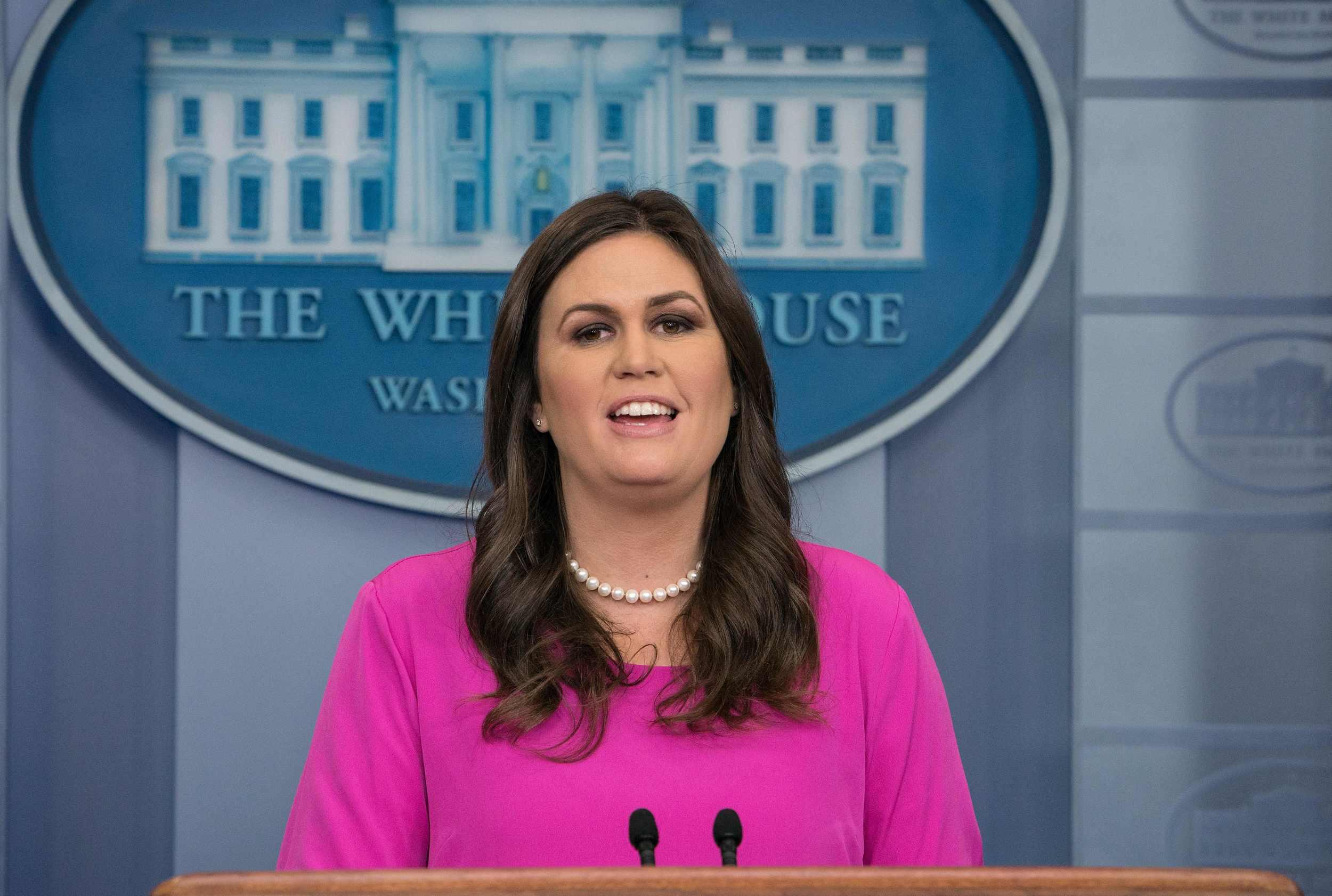 White House spokesperson Sarah Huckabee Sanders speaks during the press briefing at the White House in Washington, DC, on Octobr 30, 2017. US President Donald Trump has 'no plan or intention' to change special counsel probing possible collusion in Russia's effort to sway the 2016 presidential elections.The assurance came hours after special counsel Robert Mueller announced indictments against three Trump campaign aides, including former chairman Paul Manafort.'The president said last week and I said several times before, there is no intention or plan to make any changes in regards to the special counsel,' White House spokesman Sarah Huckabee Sanders said. / AFP PHOTO / NICHOLAS KAMM (Photo credit should read NICHOLAS KAMM/AFP/Getty Images)
