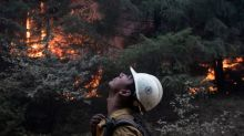 Crews battle wildfires in U.S. West as smoke travels the world