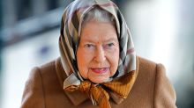 The Queen surprises in the ultimate Burberry accessory and we just love it