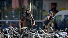 Police 'not ruling out terrorism' after man fire bombs McDonald's and takes hostage in Cologne train station