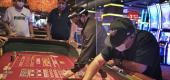 Craps players and dealers are seperated by partitions at the Golden Nugget Casino in Atlantic City, N.J. (AP Photo/Seth Wenig)