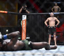UFC world in disbelief after Petr Yan's blatantly illegal knee gives title to Aljamain Sterling via DQ