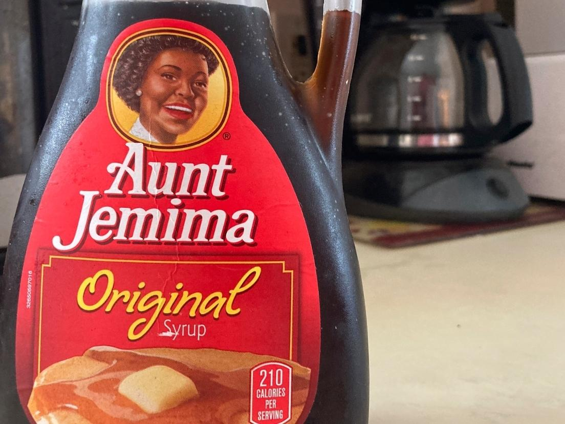 """Aunt Jemima's great-grandson says """"retiring"""" racially charged brand erases his family legacy, and America's ugly history of profiting on slave imagery."""
