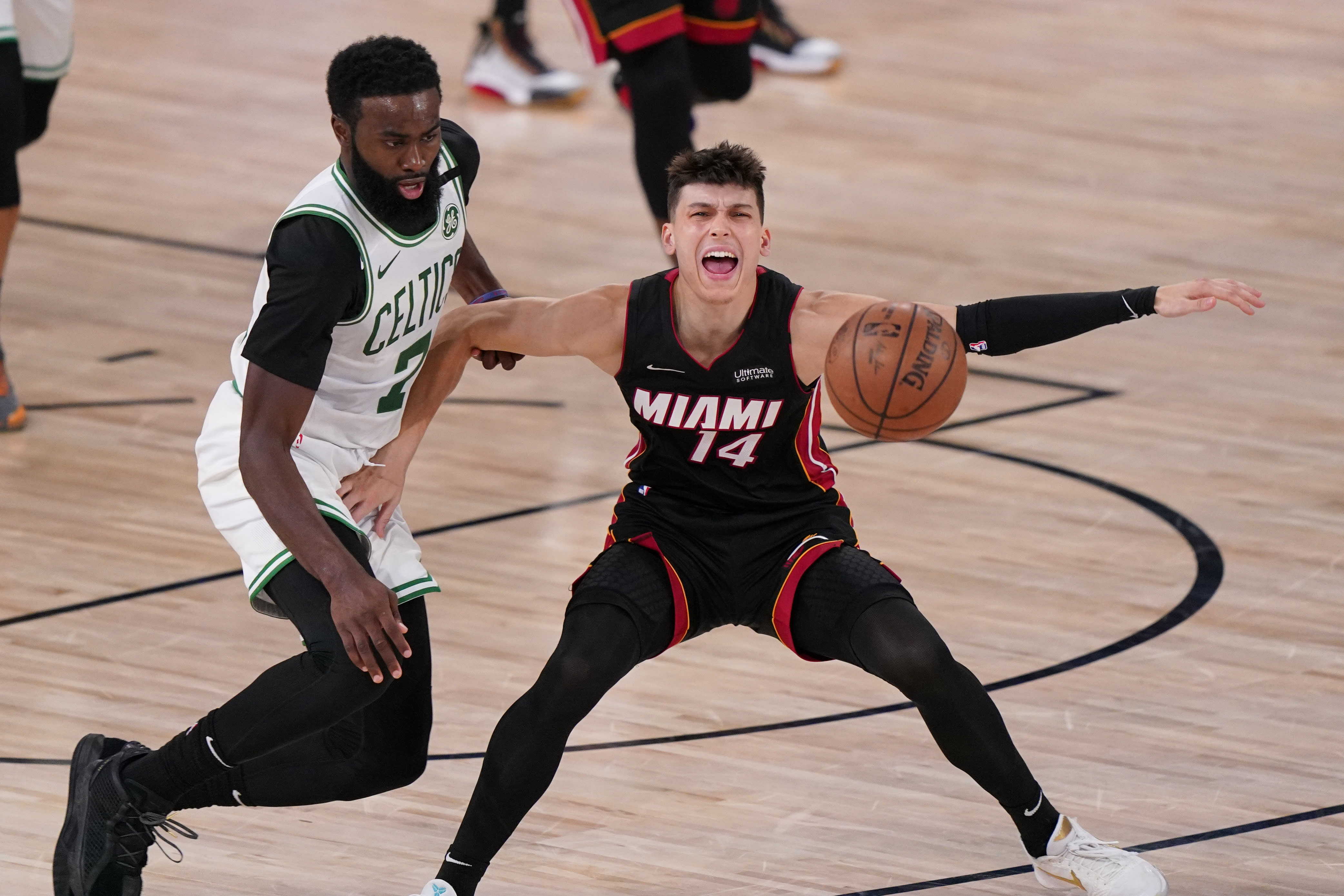 Boston Celtics' Jaylen Brown (7) stems the ball from Miami Heat's Tyler Herro (14) during the second half of an NBA conference final playoff basketball game Sunday, Sept. 27, 2020, in Lake Buena Vista, Fla. (AP Photo/Mark J. Terrill)