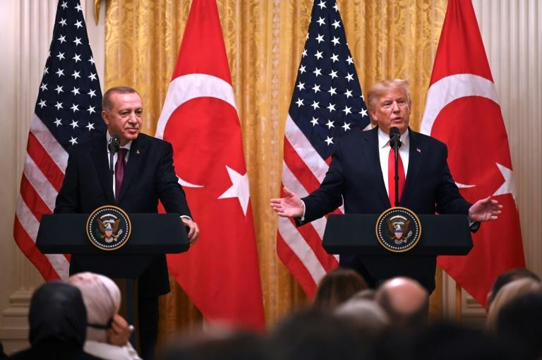 President Donald Trump steered clear of controversy as he hosted his Turkish counterpart Recep Tayyip Erdogan (AFP Photo/JIM WATSON)