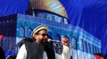 Pakistan reimposes ban on Islamist charities linked to Hafiz Saeed