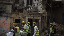 Abandoned by state after explosion, Lebanese help each other