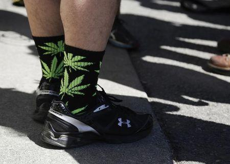 Socks with marijuana leaves are pictured at Cannabis City during the first day of legal retail marijuana sales in Seattle, Washington