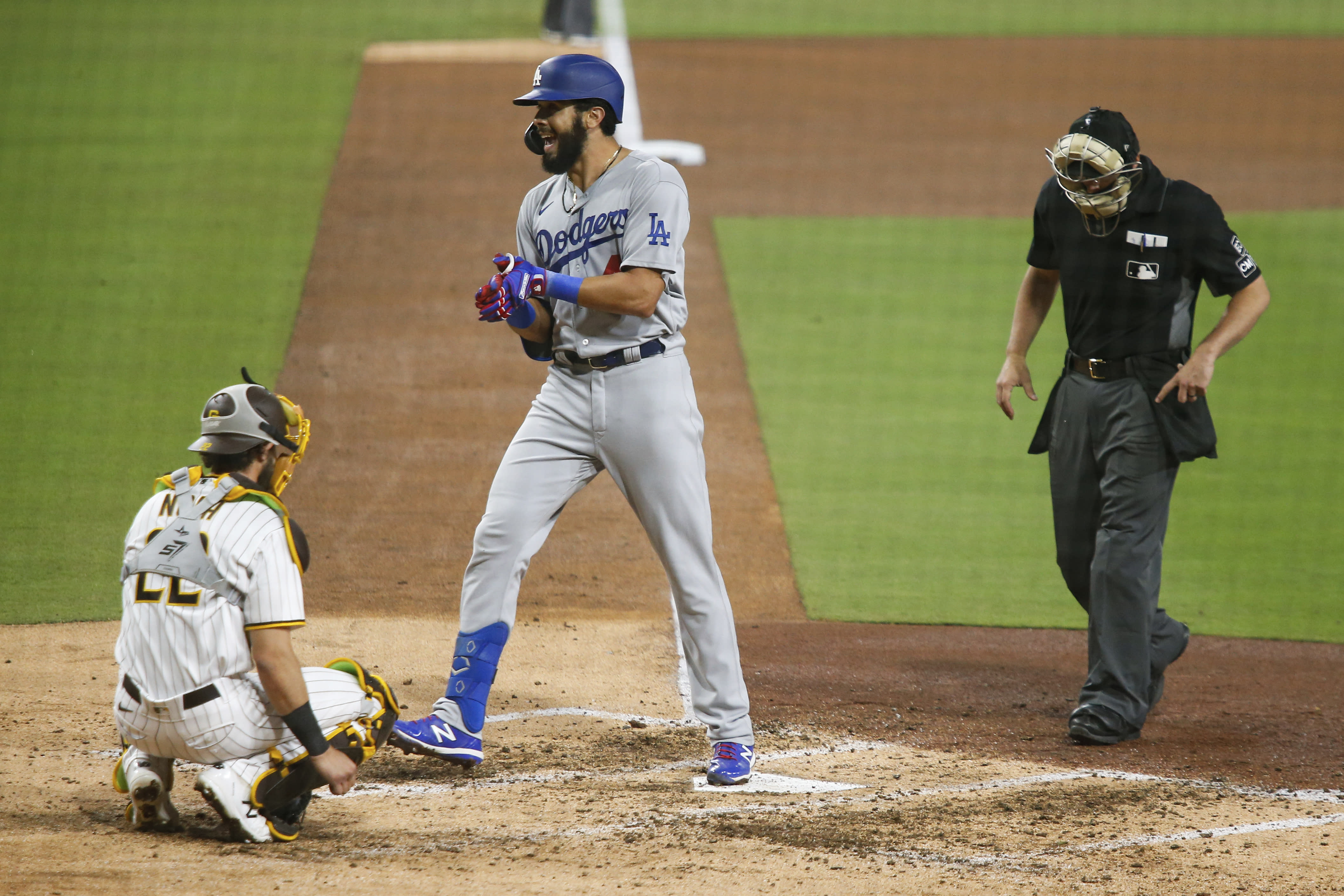 Los Angeles Dodgers' Edwin Rios reacts as he crosses home plate after hitting a solo home run against the San Diego Padres starting pitcher Zach Davies in the fifth inning of a baseball game Tuesday, Sept. 15, 2020, in San Diego. (AP Photo/Derrick Tuskan)