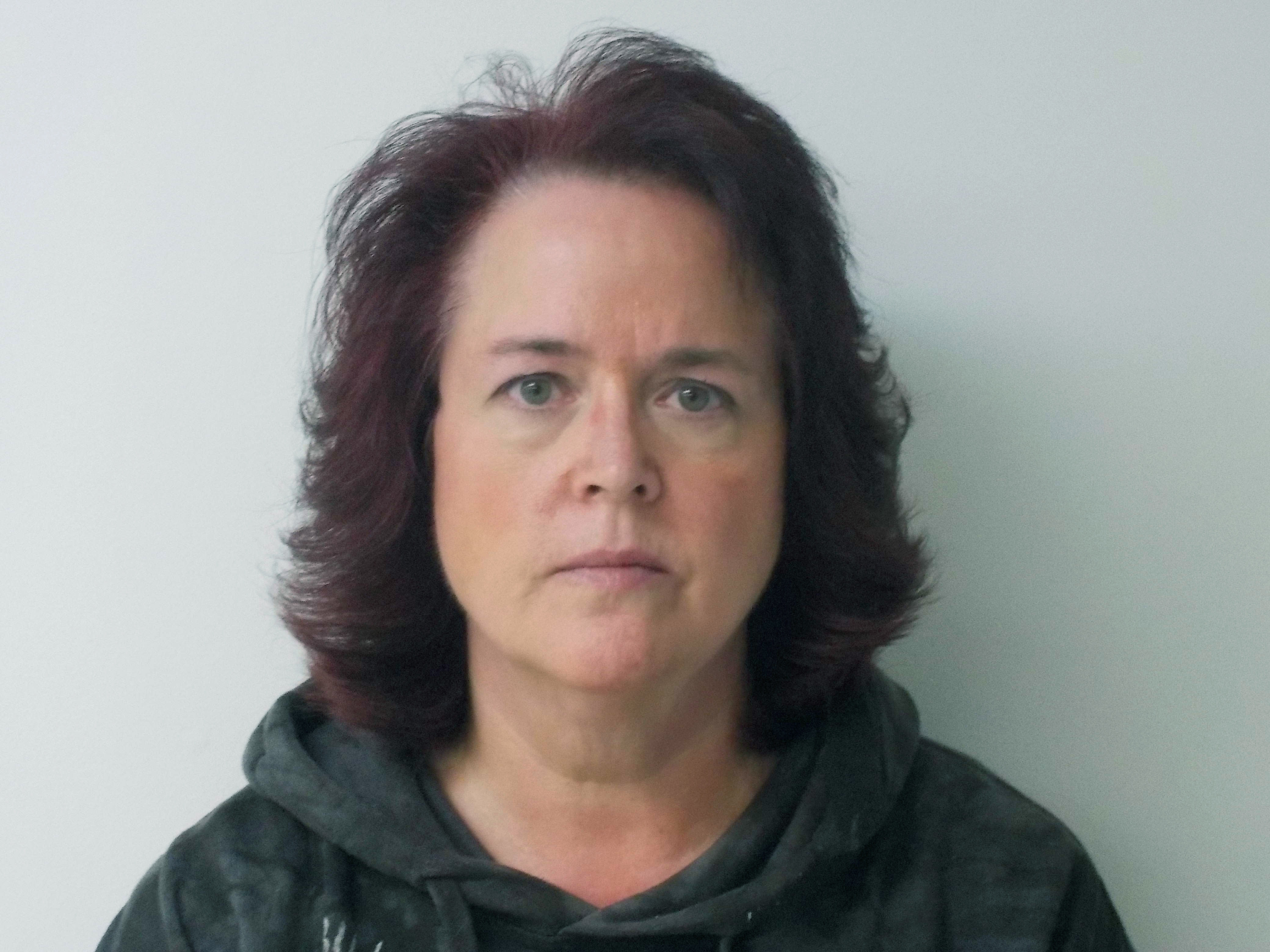 This Friday, Oct. 18, 2018 booking photo provided by New Boston Police shows Denise Atkocaitis, in New Boston, N.H. Atkocaitis, along with Thomas Atkocaitis, a married couple of New Boston, have been arrested and face several charges for allegedly constraining a girl to a small basement room for two months. (New Boston Police via AP)