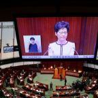 Hong Kong leader forced to abandon address, offers no olive branch