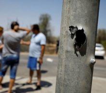 Militants' rockets, Israeli air strikes heat up Gaza border