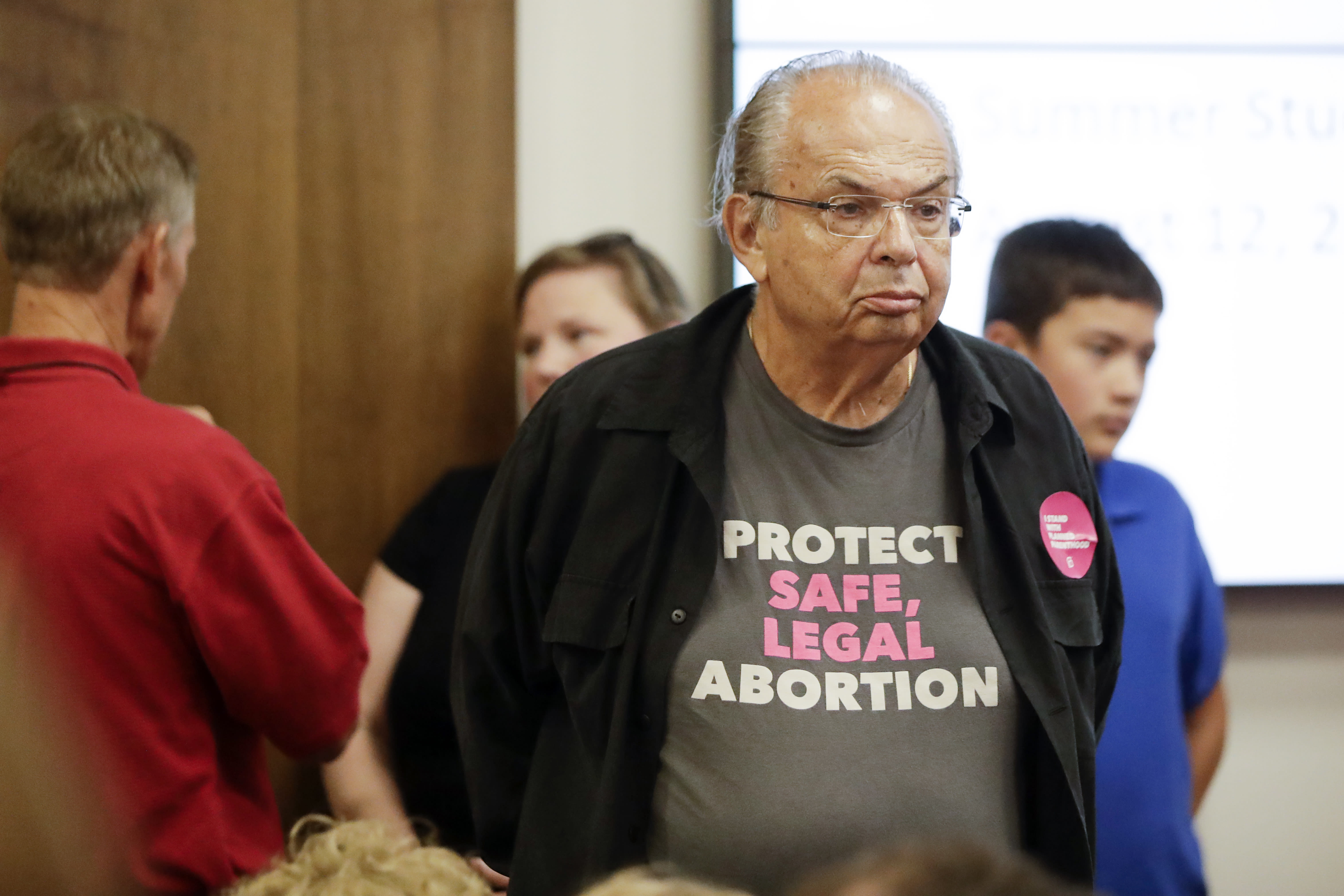 People wait for the start of a Senate hearing to discuss a fetal heartbeat abortion ban, or possibly something more restrictive, Monday, Aug. 12, 2019, in Nashville, Tenn. (AP Photo/Mark Humphrey)