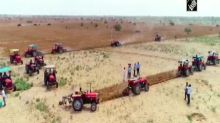 50 tractors facilitate farmers in removing wild shrubs from field