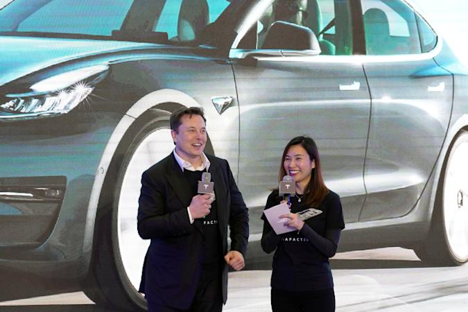 Tesla Inc CEO Elon Musk and Grace Tao, Tesla's vice president for external relations, attend a delivery ceremony for the electric vehicle (EV) maker's China-made Model 3 cars in Shanghai, China January 7, 2020. Picture taken January 7, 2020. REUTERS/Aly Song