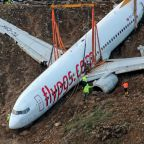 Stricken Turkish plane lifted from cliff after runway mishap