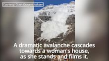 Woman films dramatic footage of avalanche crashing towards house in Norway