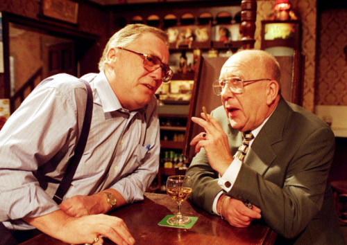 Jack Duckworth [William Tarmey] and Alec Gilroy [Roy Barraclough] chat over the bar in the Rovers in 1997 (Rex)