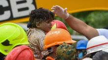 India rescuers pull 4-year-old survivor from collapsed building as toll climbs