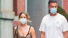 Jennifer Lawrence's Summer Dress, Mask, And Bottle Of Wine Sums Up Covid-19 Fashion