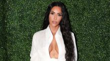 Kim Kardashian Works Out in Brother Rob's Garage Before Rocking Sexy Look: Watch