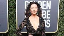 Ouch! Catherine Zeta-Jones injures foot in Christmas decorating accident