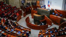 French PM defies unions with pension overhaul, they pledge more strikes
