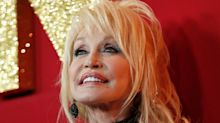 Dolly Parton avoids rides at her own theme park Dollywood, because they'll mess up her wigs