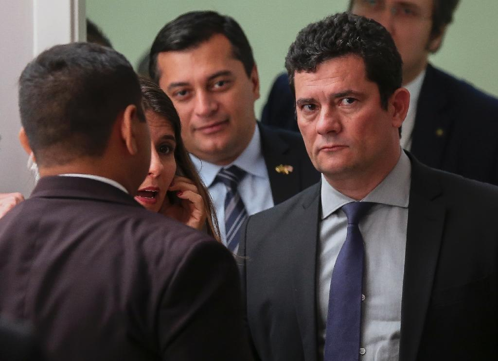 Brazilian Justice Minister Sergio Moro (R), shown in this June 10, 2019 photo, is still seen by many as an anti-corruption crusader. He has denied any wrongdoing (AFP Photo/Michael DANTAS)