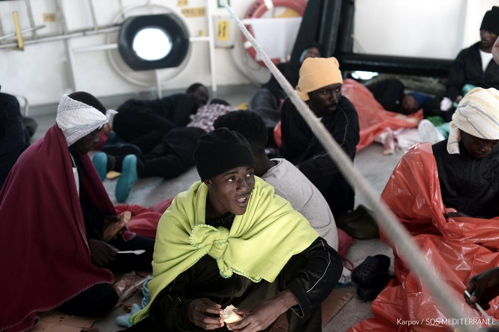 A migrant onboard the Aquarius rescue ship as it heads towards Spain (AFP Photo/Kenny Karpov)