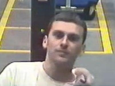 Police launch appeal to find man who licked woman's face on train