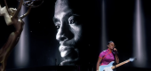 Chadwick Boseman depicted on a screen as H.E.R. sings. (Television Academy)