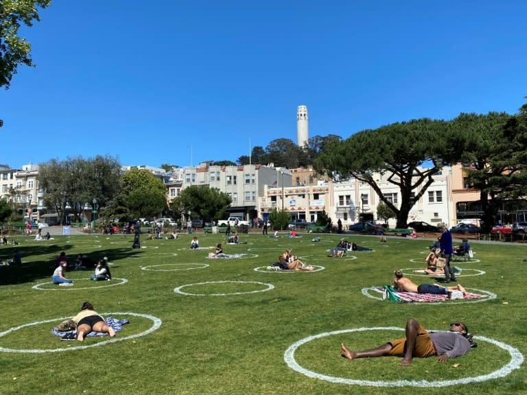 People practice social distancing at Washington square park in San Francisco