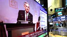 Stocks surge, Powell says rates 'just below' neutral