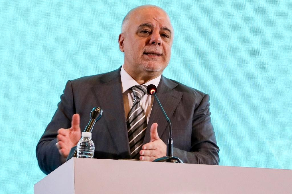 Prime Minister Haider al-Abadi has said Iraq will reluctantly comply with US sanctions against its ally Iran