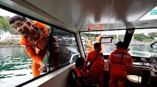 Distraught relatives slam Indonesia's government over ferry safety measures as 190 presumed drowned
