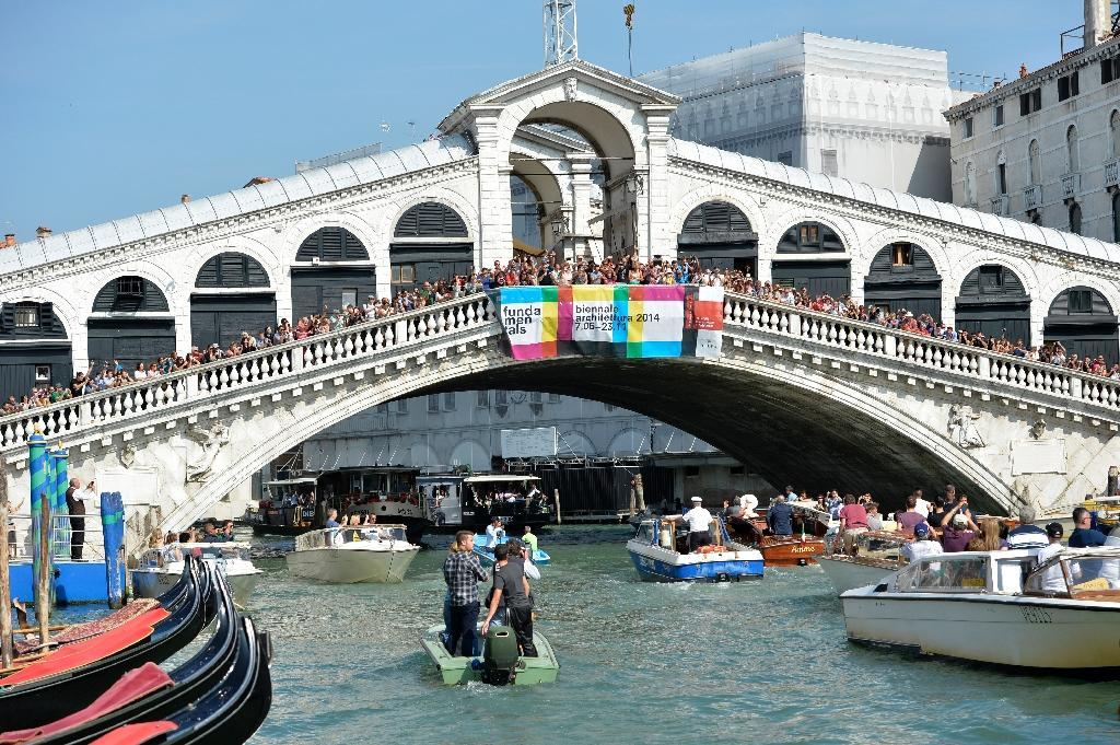 The Rialto Bridge is the oldest of the four bridges that span Venice's Grand Canal, first built at the end of the 12th century