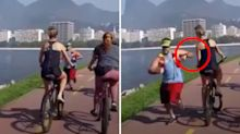 Jogger knocks woman off bike in 'disgusting' act