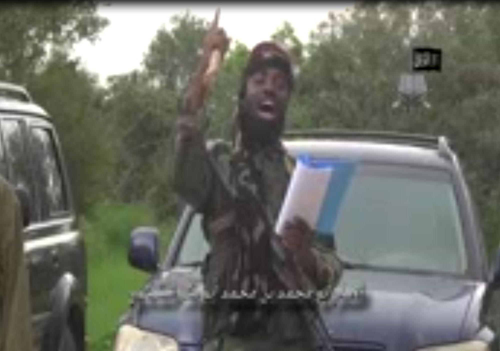 A screengrab taken on August 24, 2014 from a video released by the Nigerian Islamist extremist group Boko Haram shows the group's leader, Abubakar Shekau, delivering a speech at an undisclosed location