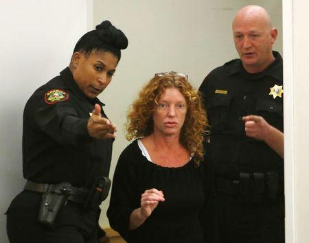 Deputies direct Tonya Couch to the defense table before her bond reduction hearing in Criminal District Court in Fort Worth
