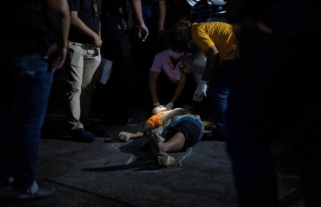 Nearly 2,000 people have been killed since Philippine President Rodrigo Duterte was sworn into office on June 30, 2016, and immediately launched his war on crime (AFP Photo/Noel Celis)