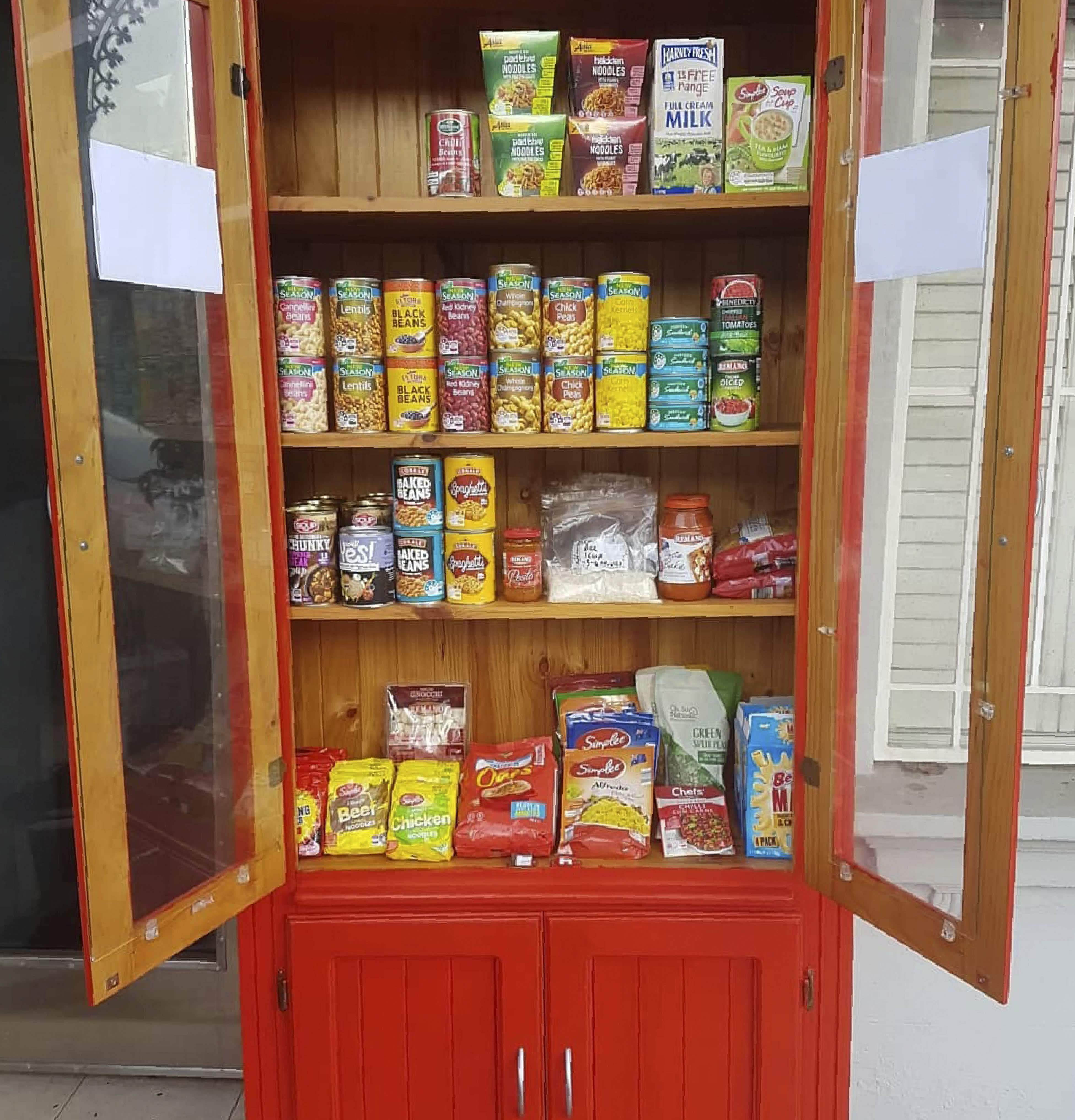 In this July 19, 2020 photo provided by Rick Everett, a free food pantry sits outside his home in Sydney, Australia, where he offers coffee, home-cooked meals and conversation to friends and neighbors during the coronavirus pandemic. (Rick Everett via AP)