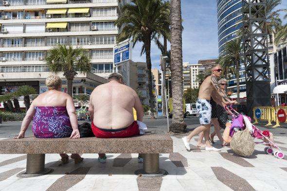 """Save your bikini for the beach! While men walking around topless and women wearing Daisy Dukes and a bikini top to hit the shops may be accepted in your local town, not covering up abroad could get you arrested. <a href=""""http://travel.aol.co.uk/2014/04/29/bikini-ban-majorca-tourists-face-500-fine-for-leaving-beach-topless-swimwear/"""" target=""""_blank"""">Majorca recently introduced a bikini ban</a> meaning tourists caught topless or wearing swimwear on the streets could be fined £500."""