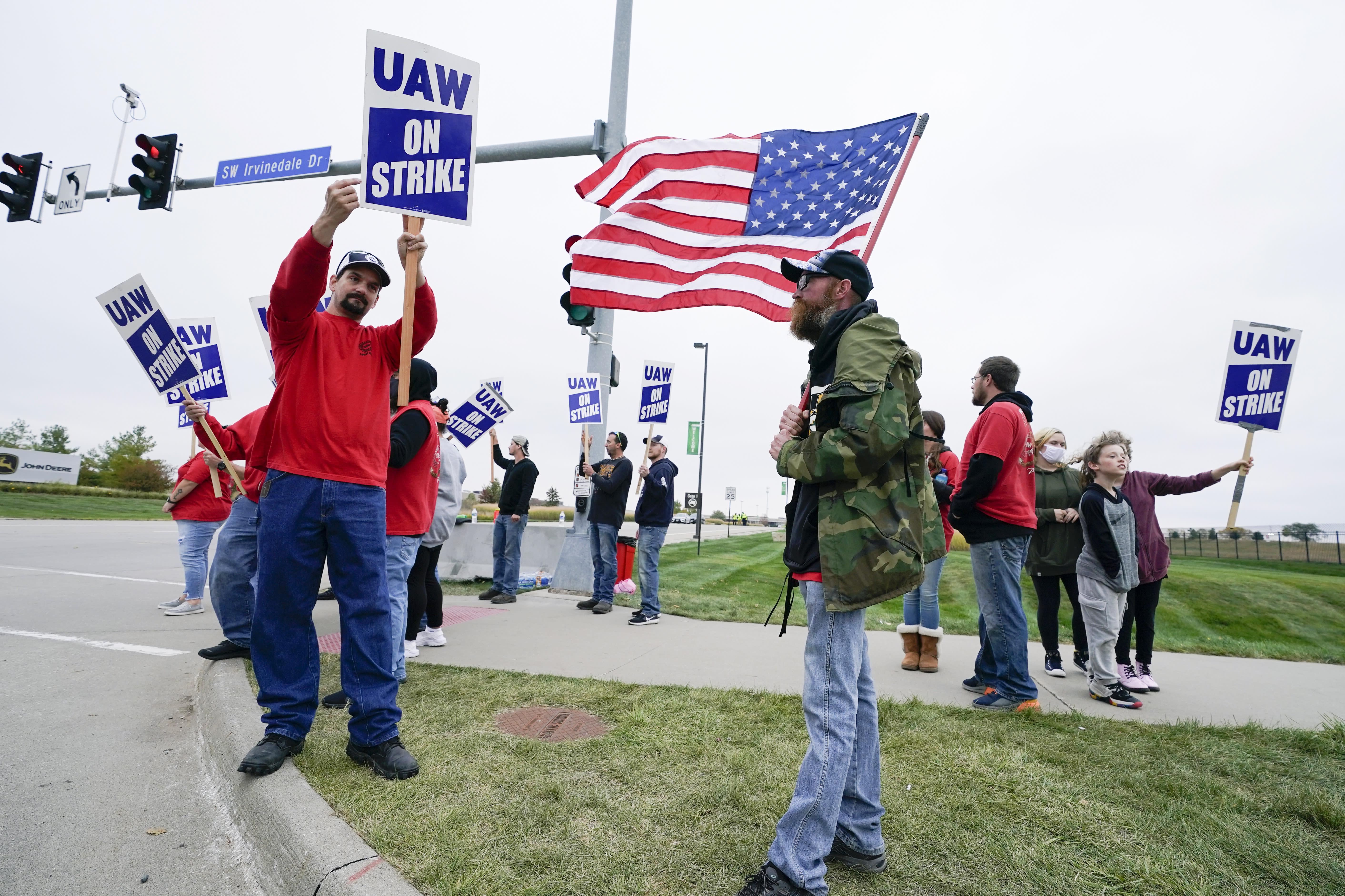 Judge limits strikers' conduct at Deere plant in Iowa